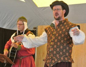 "Performing ""Hidden Gold"" with Efenwealt Wystle on guitar, at Drake's 2015 Pennsic concert. Photo credit: Suzan Longo."