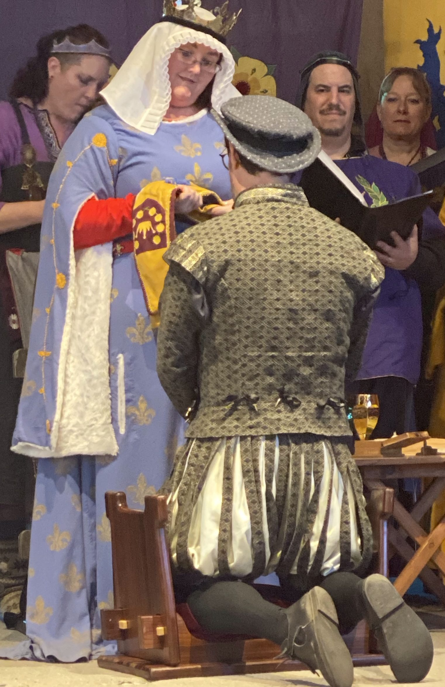 Drake receiving his Queen's Bard baldric from HRM Margarita